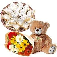 12 Gerbera Bouquet, 500 gms Kaju Burfi, 1 Teddy Bear