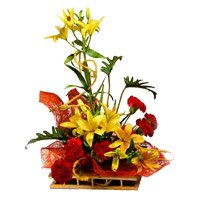 6 Yellow Lily 6 Red Carnation Flower Arrangement