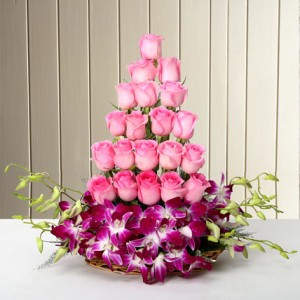 Basket arrangement of 20 Pink Roses and 6 Purple Orchids