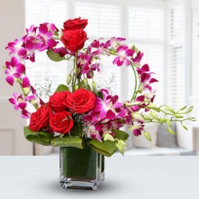 6 Red roses & 7 stems orchids in Vase