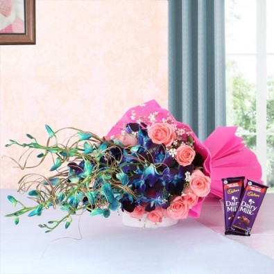 6 Blue Orchids and 12 Pink Roses with 2 Cadbury Dairy Milk