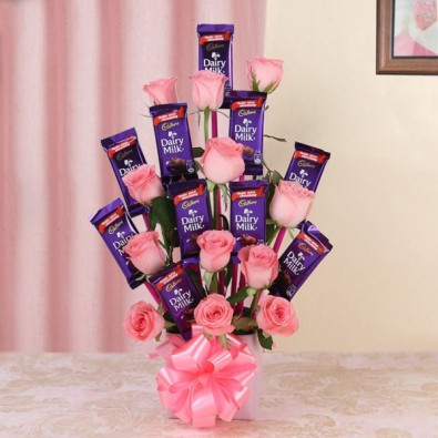 12 Pink Roses with 10 Dairy Milk Chocolates