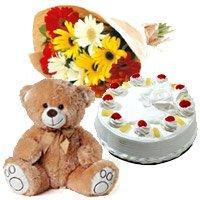 12 Gerbera Bouquet, 1 Kg Pineapple Cake and 1 Teddy Bear