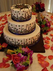 3 Tier 3 Kg Butter Scotch Cake with Exotic Flower Bunch   (On Two Days Prior Order)