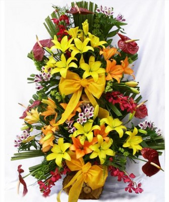 A Big exotic flowers basket of 3 feet to 4 feet with lilies, anthaniums and orchids
